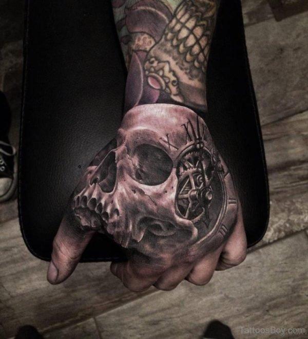 Skull And Clock Tattoo On Hand