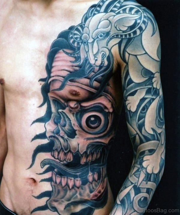 Skull And Dragon Mens Chest Tattoo