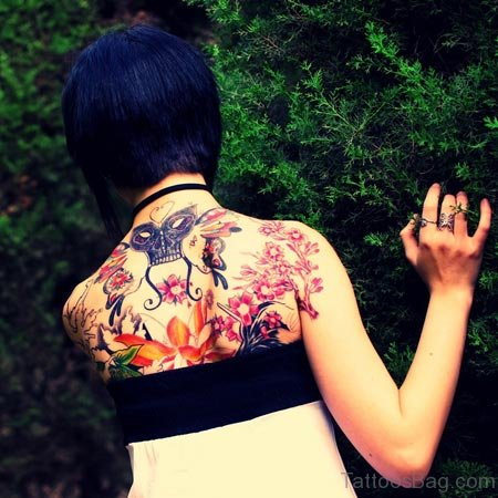Skull And Flowers Back Tattoo