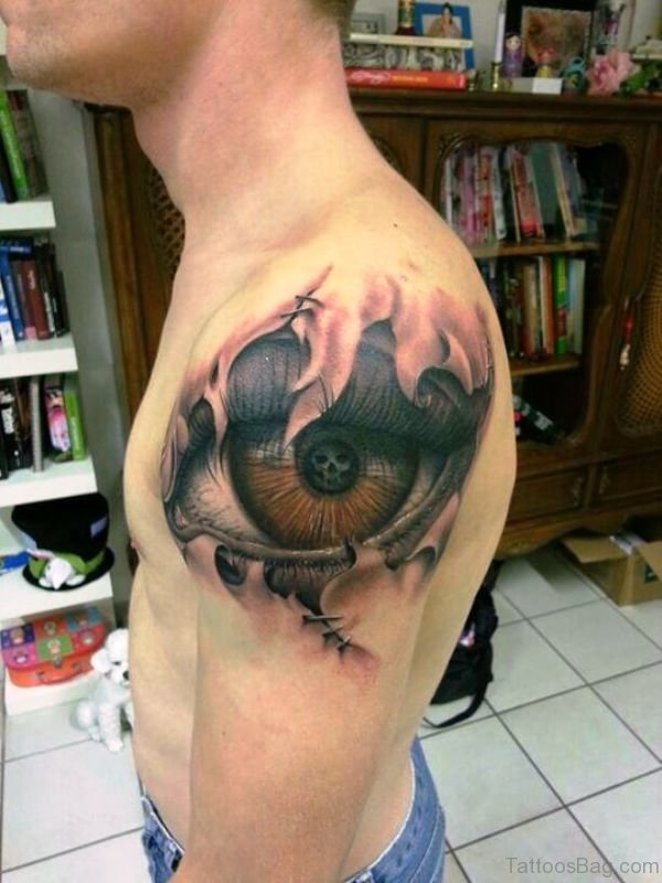 Skull In Brown Eye Tattoo On Shoulder