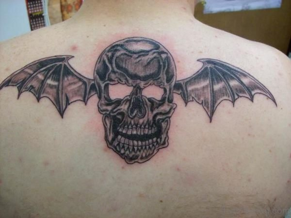 Skull With Bat Wings Tattoo On Upper Back