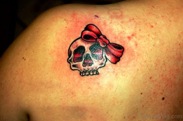 Skull With Bow Tattoo On Back Shoulder