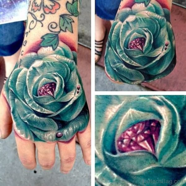 Sky Blue Rose Hand Tattoo