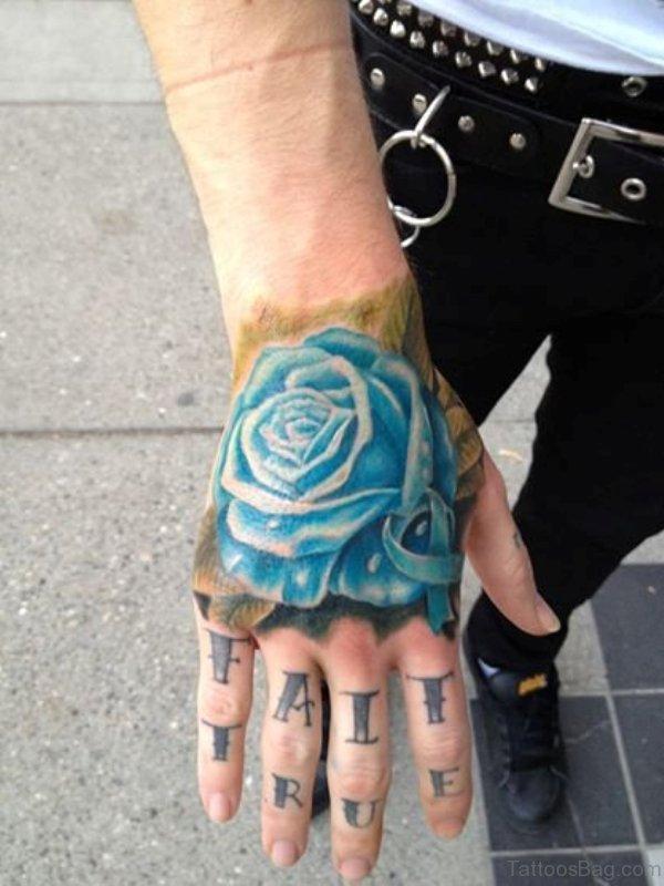 Sky Blue Rose Tattoo On Hand
