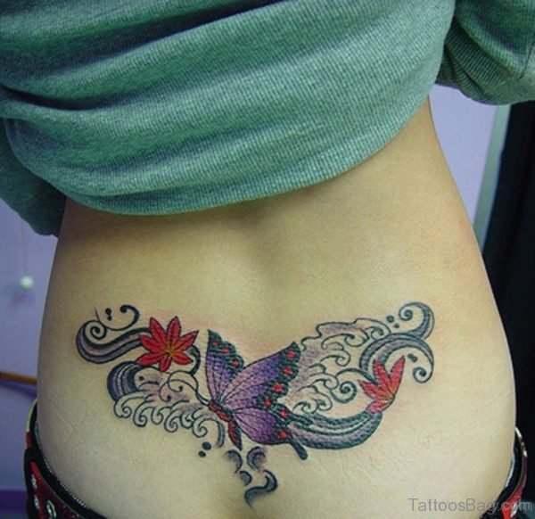 Small Butterfly And Flower Tattoo On Lower Bacl