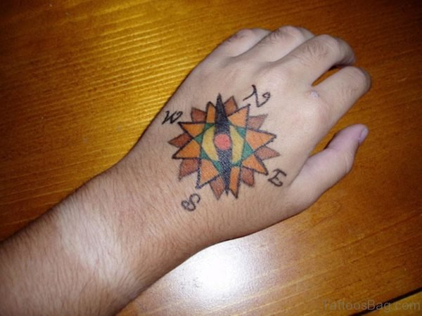 Small Colored Compass Rose Tattoo On Hand