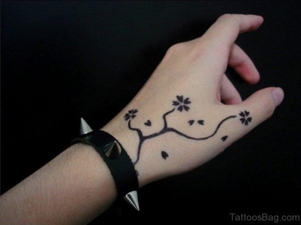 Small Flower Tattoo Designs On Hand