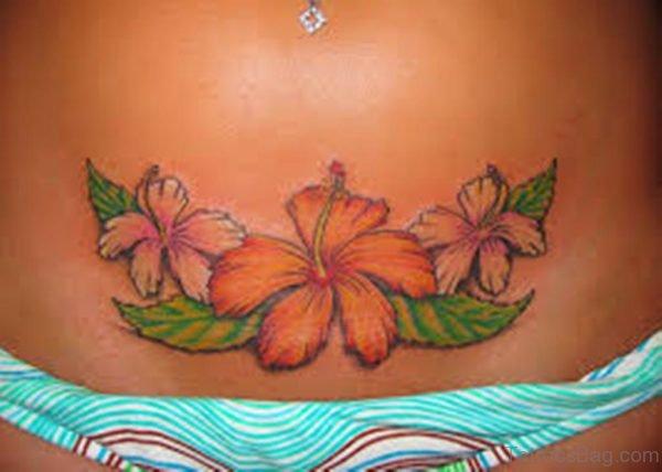 Small Hummingbird And Flower Tattoos On Waist