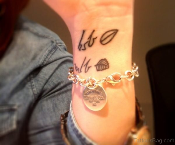 Small Leaf Tattoo On Wrist