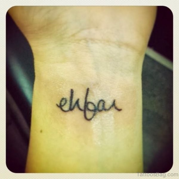 Small Letter Wrist Tattoo