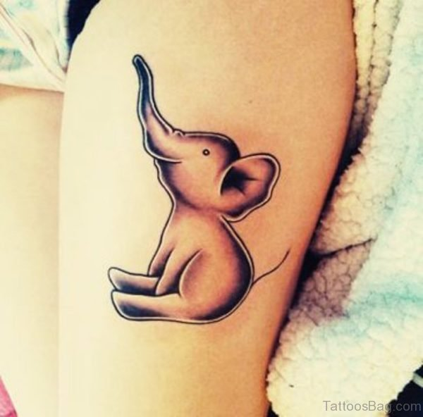 Small Sitting Elephant Tattoo On Thigh