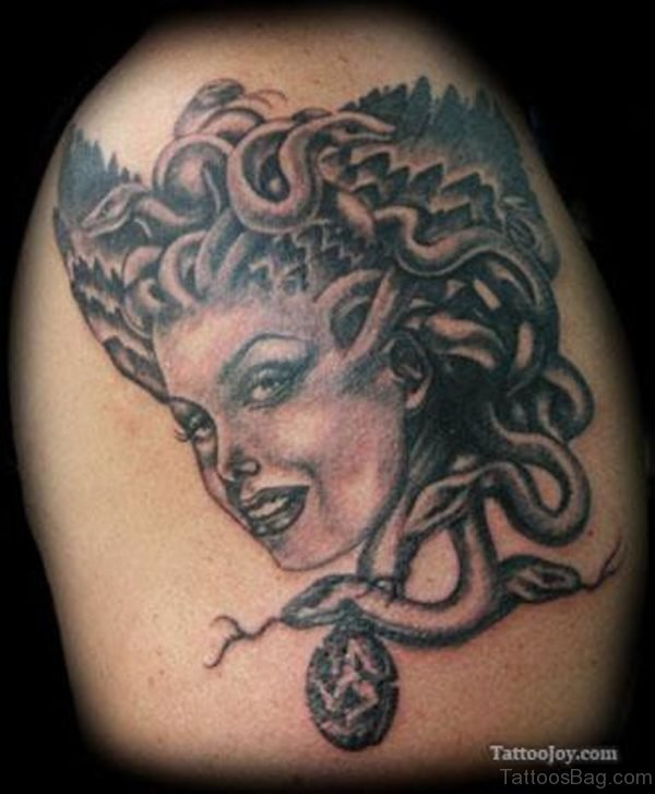 Smiling Medusa Tattoo On Shoulder