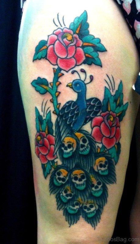 Strange Peacock Tattoo With Skull