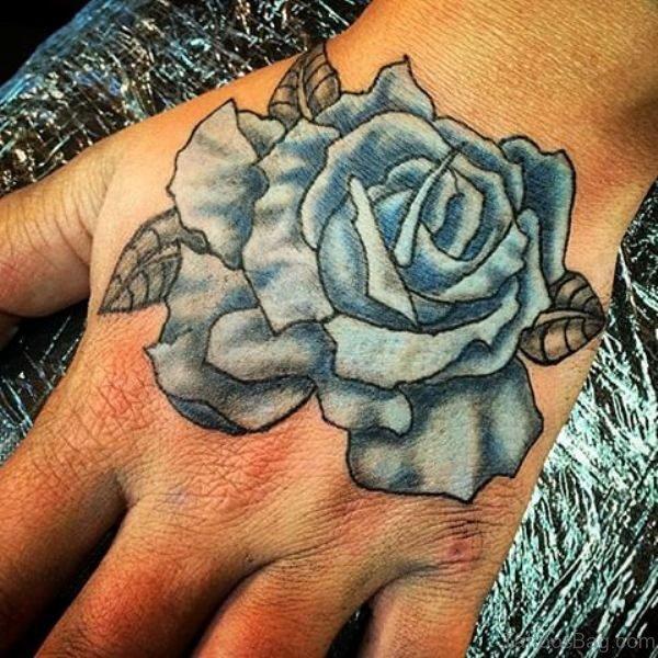 Stunning Blue Rose Hand Tattoo