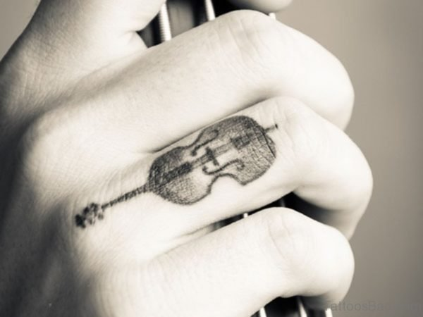 Stunning Guitar Tattoo On Finger