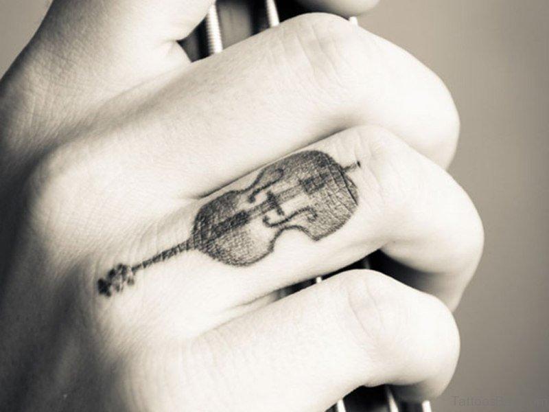 7 Tiny Guitar Tattoos On Finger