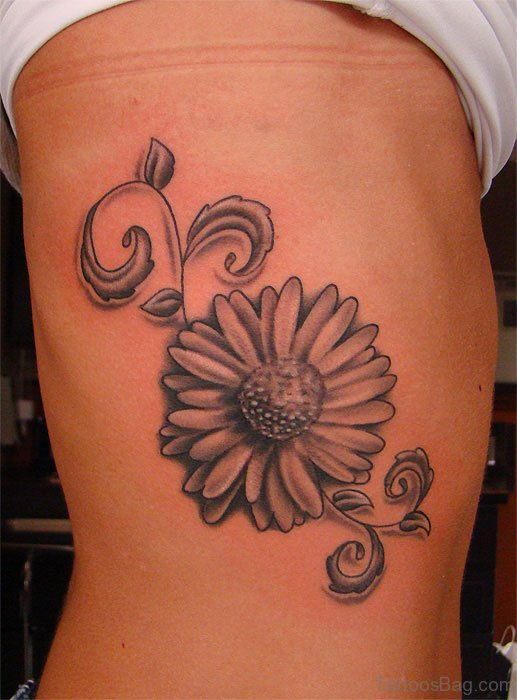 Stylish Daisy Flower Tattoo On Rib