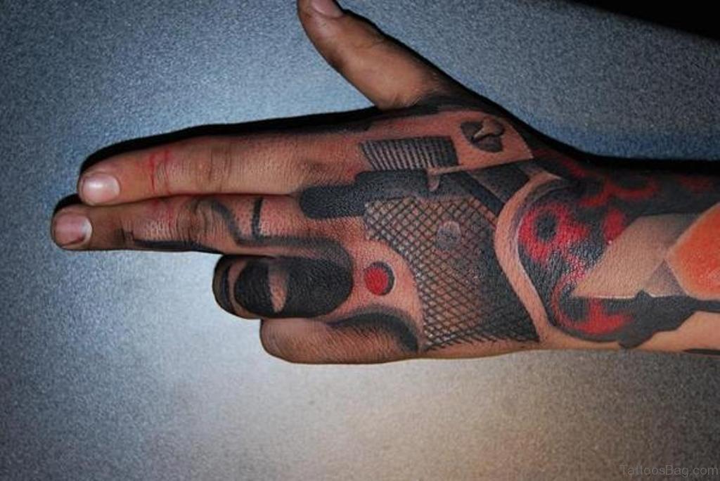 Small Tattoo Guns: 28 Funky Gun Tattoos On Hand