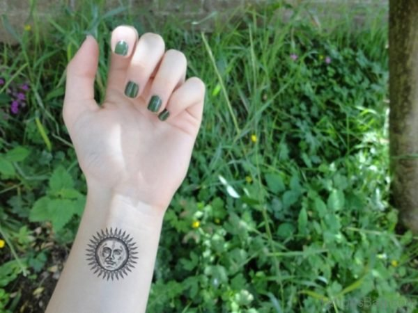 Sun Tattoo On Wrist