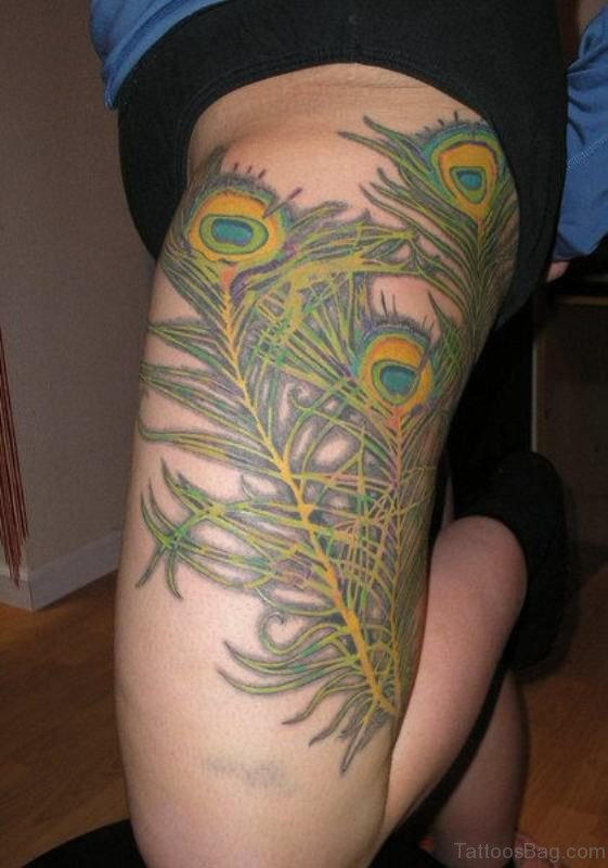 Supurb Peacock Feather Tattoo On Thigh
