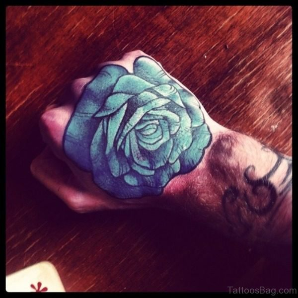 Sweet Blue Rose Tattoo On Hand