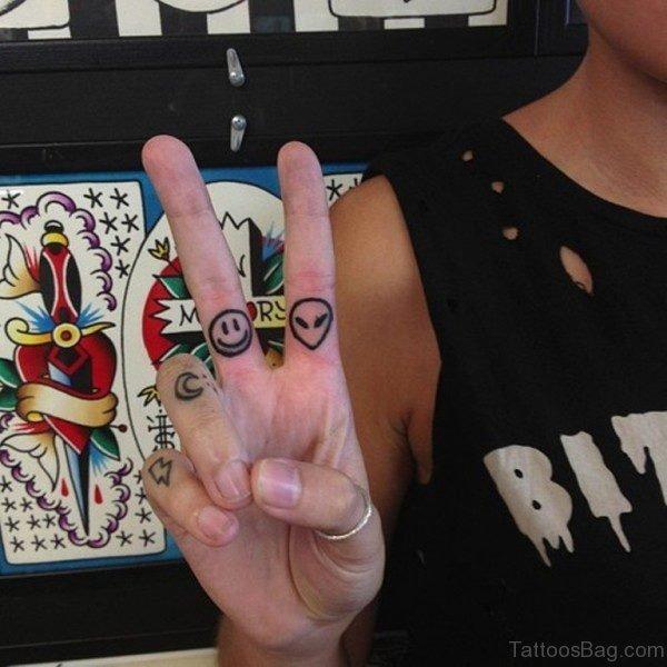 Sweet Cartoon Tattoo On Finger