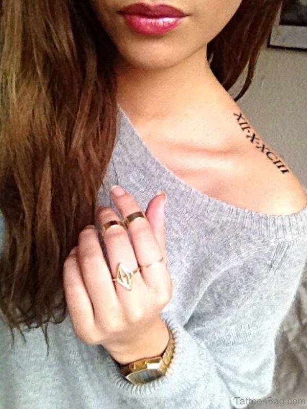 Sweet Roman Numeral Shoulder Tattoo