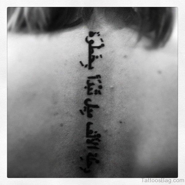 Terrific Arabic Tattoo On Back