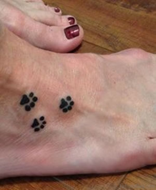 Three Tiny Paw Tattoo