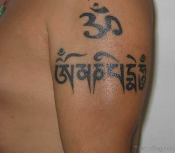 Tibetan Script With Om Tattoo On Left Shoulder