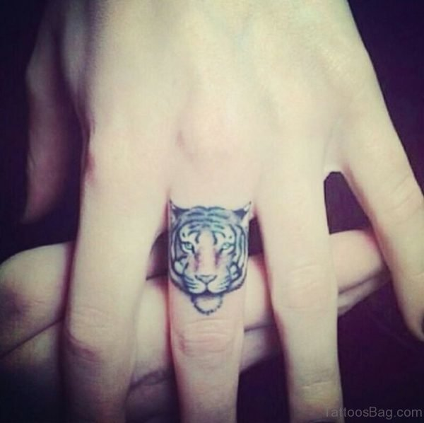Tiger Face Tattoo On Finger