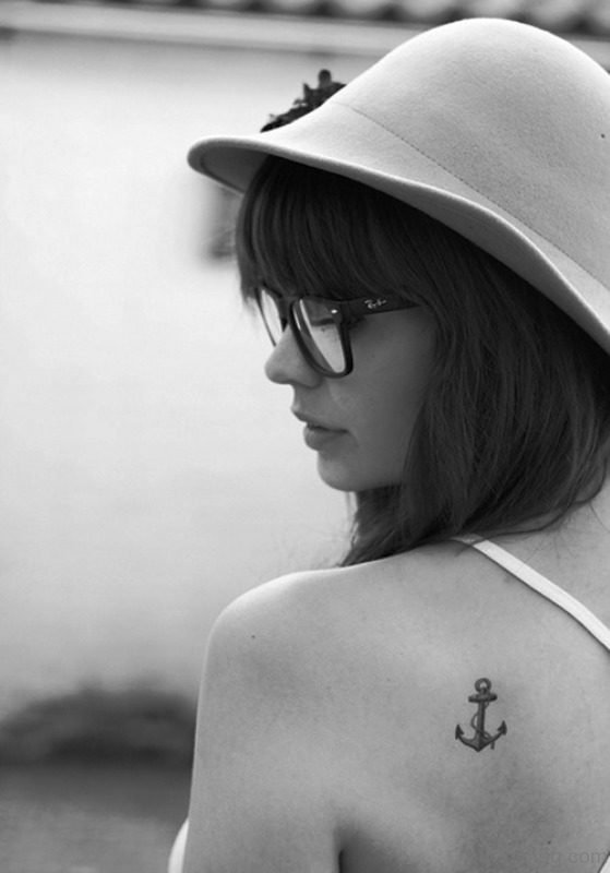 Tiny Anchor Tattoo On Back Shoulder