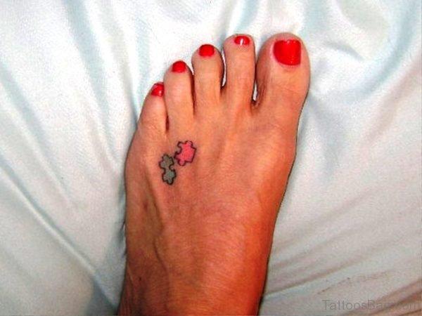 Tiny Autism Tattoo On Foot