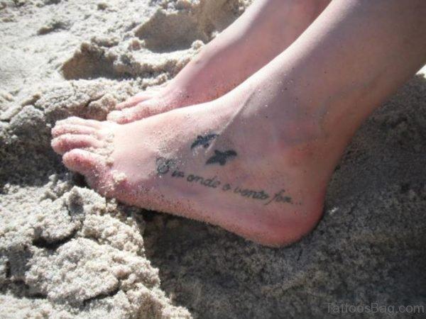 Tiny Bird Tattoo On Foot