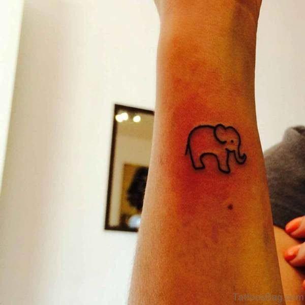 Tiny Elephant Tattoo On Forearm
