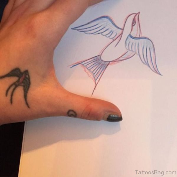 Tiny Swallow Tattoo