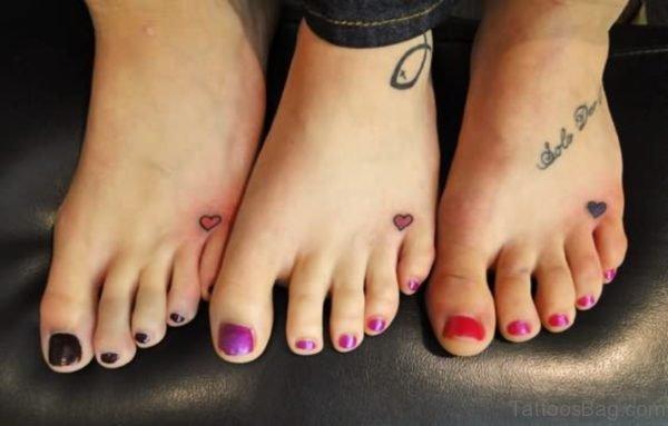 Tiny Three Heart Tattoo On Foot