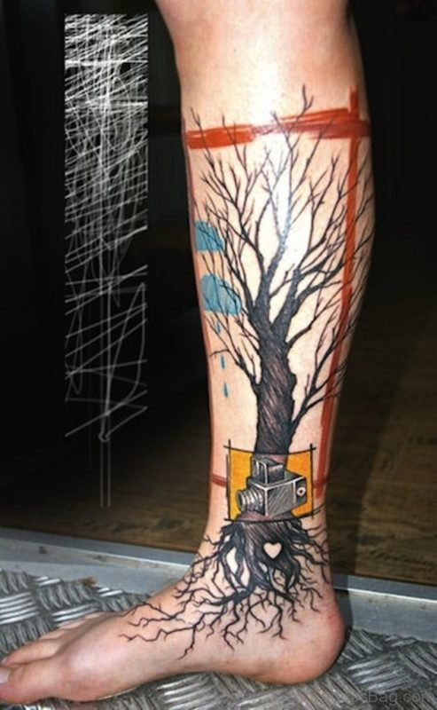 Tree Without Leaves With Camera Tattoo On Leg