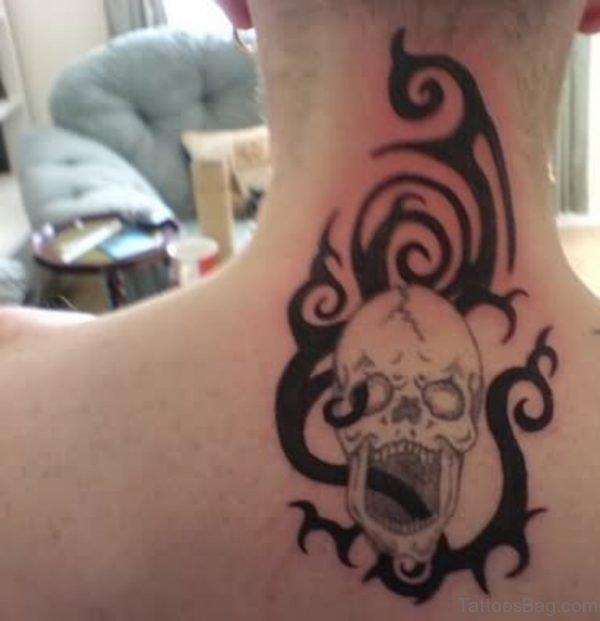 Tribal And Skull Tattoo On Upperback