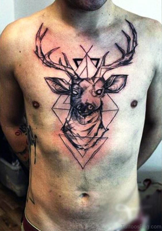 Tribal Buck Tattoo On Chesrt