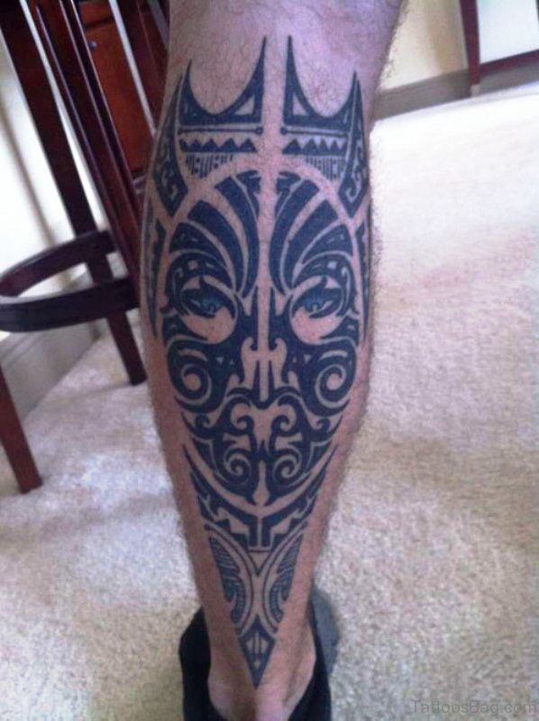 Tribal Face Tattoo On Calf