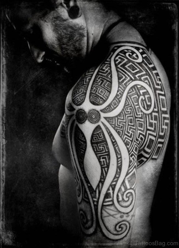 Tribal Shoulder Tattoo On Left Shoulder