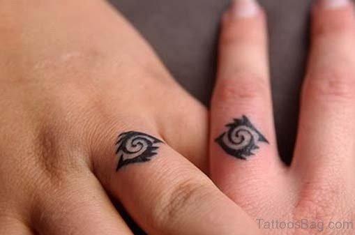 Tribal Wedding Ring Tattoo On Finger