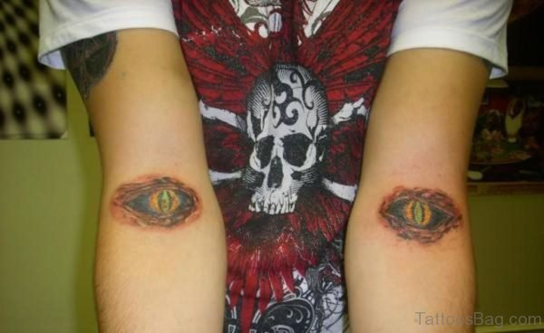 Twin Eyes Tattoo On Arm