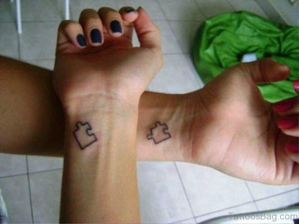 Two Autism Tattoos On Both Wrist