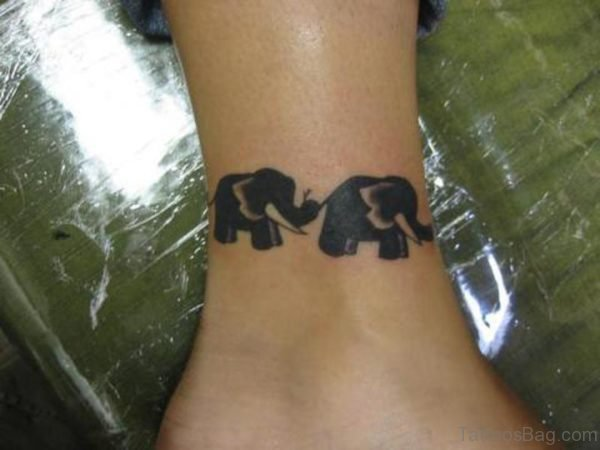 Two Black Elephnat Tattoo On Ankle