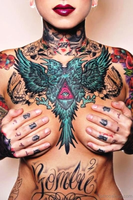 Two Faced Blue Bird Tattoo On Chest