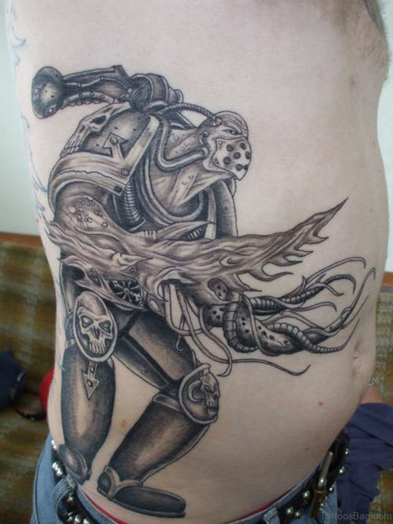 34 excellent rib tattoos for Tribal warrior tattoos