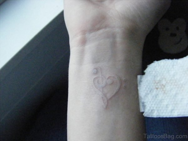 Whit Ink Music Heart Tattoo On Wrist