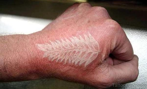 White Ink Feather Tattoo On Hand